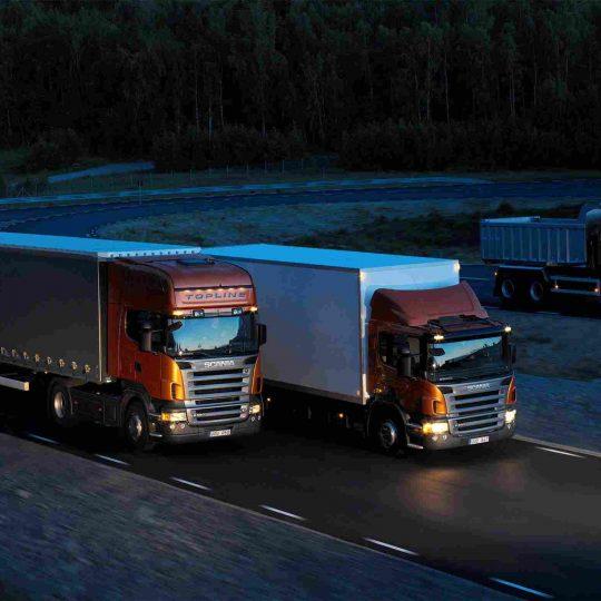 http://transportadorapremier.com.br/wp-content/uploads/2015/09/Three-orange-Scania-trucks-540x540.jpg